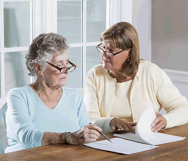 elderly woman reviewing paperwork