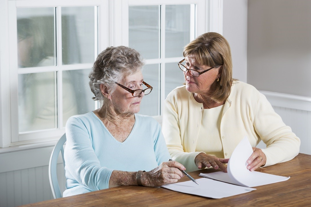 women helping mother with paperwork